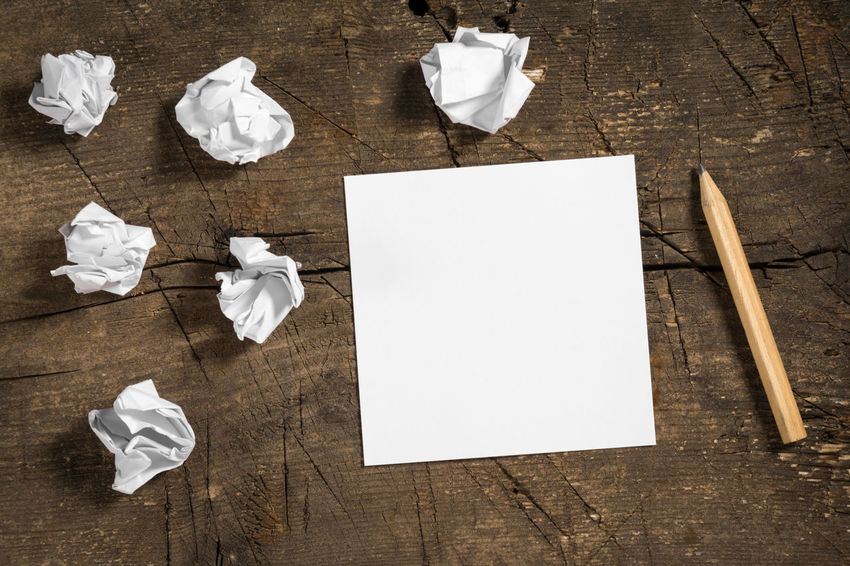 Blank white note paper with a pencil and some crumpled papers on wooden surface Brainstorming Decisions Imagination Planning Schedule Solving Thinking Writing Blank Communication Creativity Crumpled Crumpled Paper Ball Failure  Ideas Inspiration Keep Trying Message Note Old Paper Pencil Problem Solution Wooden