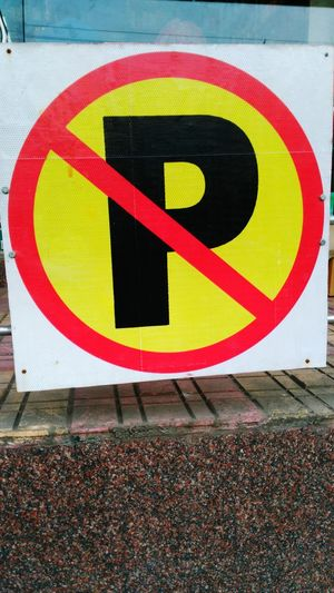 """NO PARKING"" Zone Day Communication No People Outdoors Multi Colored Close-up"