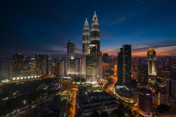 Dusk at Petronas Towers Architecture Built Structure Capital Cities  Cities At Night City City Life Cityscape Cityscape Dusk Financial District  Illuminated Kuala Lumpur Modern Night Office Building Petronas Twin Towers Sky Skyscraper Sunsetdusk Tall Tall - High The Great Outdoors - 2016 EyeEm Awards The Great Outdoors With Adobe Tower Urban Skyline