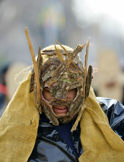 Close-up of man wearing mask at carnival