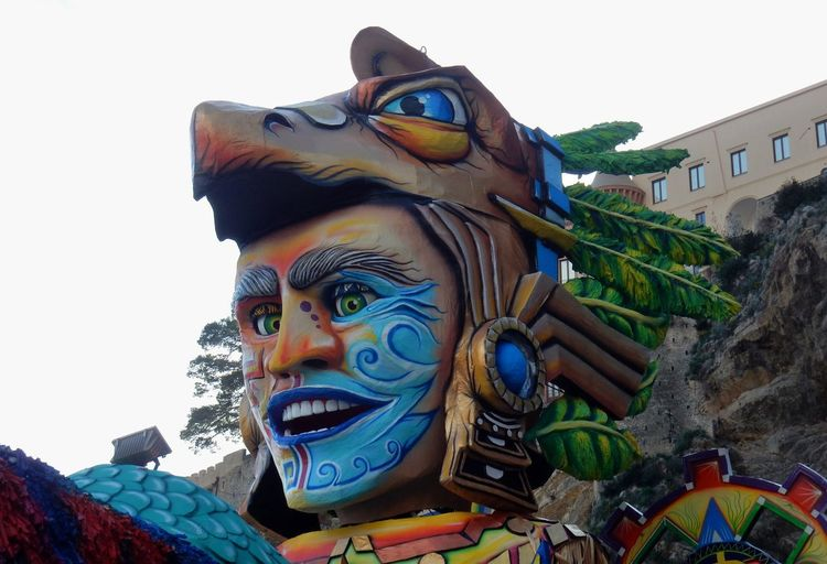 Maiori, Campania, Italy - March 4, 2019: Allegorical floats in the square of the port for the 46th edition of the Grand Carnival of Maiori Italy Campania Salerno Italy Grand Carnival Of Maiori Amalfi Coast Colorful Floats Carnival - Celebration Event Allegorical Floats Maiori, Day Representation Art And Craft Human Representation Sculpture Sky Creativity Multi Colored Low Angle View Statue Male Likeness Clear Sky No People Belief Outdoors