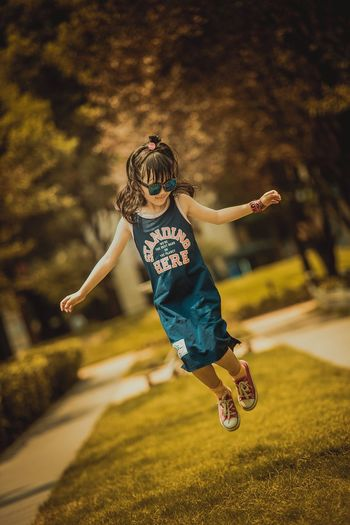 WeChat:13647636140 Mid-air Full Length Jumping One Person Motion Focus On Foreground Childhood Elementary Age Lifestyles Energetic Real People Outdoors Day Tree People