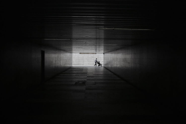 Distant view of woman seen through tunnel