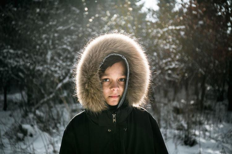 Portrait of boy wearing fur coat
