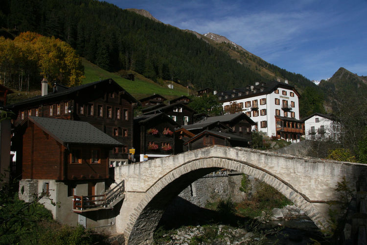 The Bogenbrucke (arched bridge) in Binn, Valais is listed as a Swiss heritage site of national significance. The Binntal (Binn valley) is also famous for its rich mineral deposits and is popular with hikers; but then where isn't, in Switzerland. Autumn Binntal Hiking Houses Michel Guntern Minerals Schweiz Suisse  Travel Travel Photography Valais Arch Arched Bridge Binn Blue Sky Bogenbrücke Mountain No People Stone Bridge Swiss Switzerland Travel Pics Village Wallis Wooden
