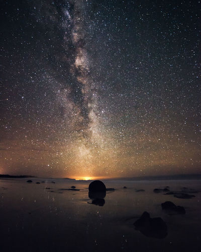 Moeraki Boulders Astronomy Beauty In Nature Galaxy Horizon Horizon Over Water Idyllic Land Milky Way Nature Night No People Outdoors Rock Scenics - Nature Sea Sky Space Star - Space Tranquil Scene Tranquility Water