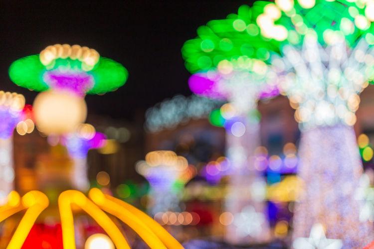 Defocused image of illuminated carousel