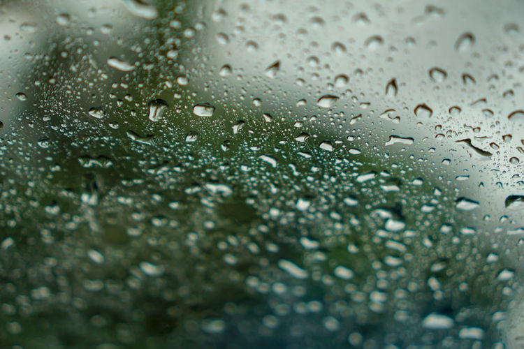 blur backgruond,Rain water on the car glass Purity Day Rainy Season Indoors  Full Frame Transparent No People Glass - Material Selective Focus Close-up Wiper Windshield Window White Wet Weather Water View Up Traffic Texture Sweat Surface Storm Shape Season  Reflection Rainy RainDrop Rain Pattern Night Nature Moisture Liquid Light Glass Drops Drop Driving Color Closeup Close Clear Clean Car Bubble Blue Backgrounds Background Abstract Indoors