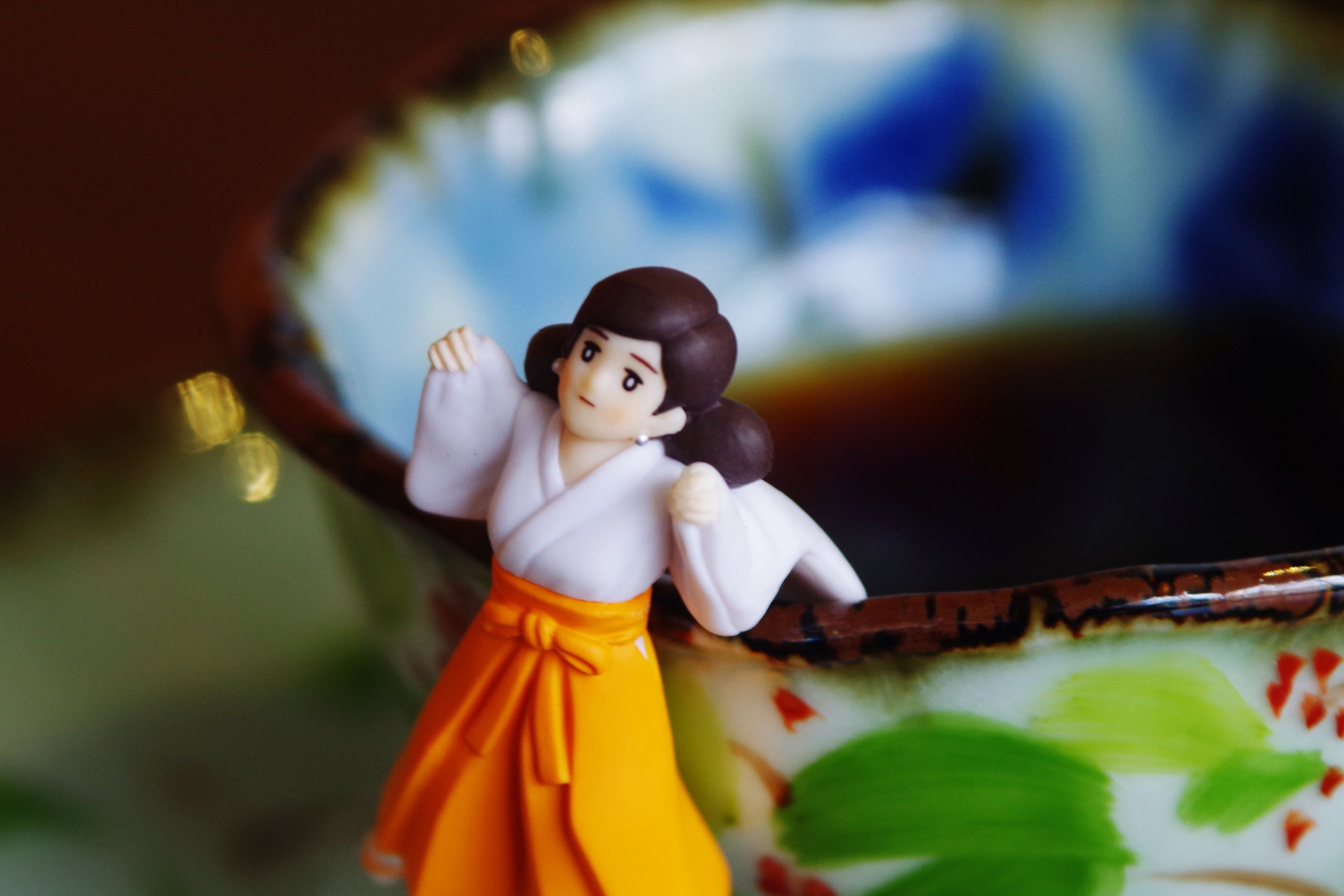 indoors, art, art and craft, human representation, flower, creativity, focus on foreground, animal representation, selective focus, religion, statue, figurine, close-up, sculpture, toy, spirituality, decoration, tradition