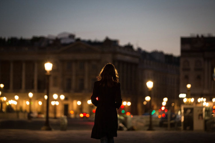 A actress in paris Illuminated Architecture One Person City Standing Building Exterior Night Street Adult Real People Built Structure Focus On Foreground Women Lifestyles Young Adult Three Quarter Length Nature Leisure Activity Winter Warm Clothing Outdoors Hairstyle Paris France Actress