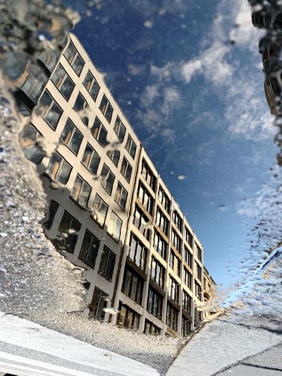 Sky Nature No People Apartment Construction Industry Window Reflection Low Angle View Outdoors Puddle Pattern Day City Building Sunlight Tilt 17.62°