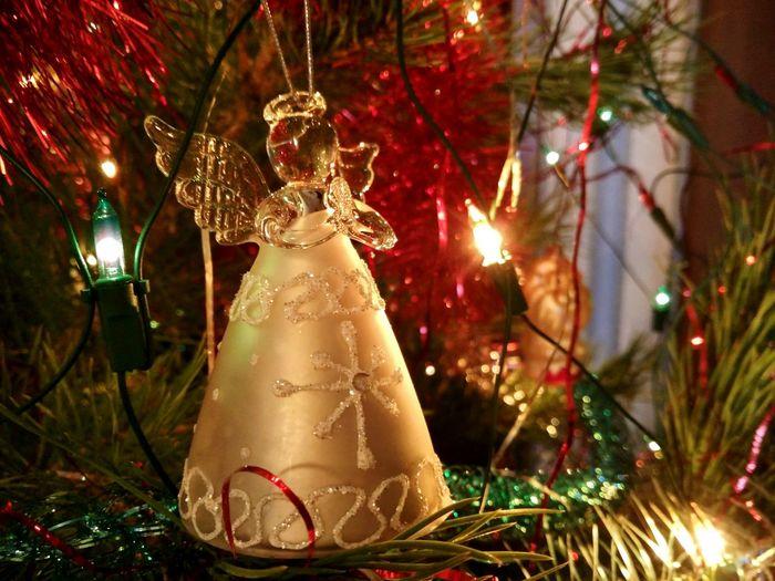 Close-Up Of Decoration Hanging On Illuminated Christmas Tree