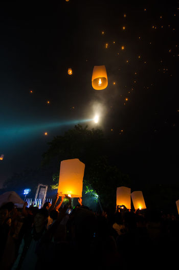 15 may 2014, Magelang, Indonesia : Participants releasing lanterns over the Borobudur temple in Magelang, Central Java during Vesak/Waisak Day celebrations. Architecture Arts Culture And Entertainment Celebration Crowd Enjoyment Event Excitement Festival Group Of People Illuminated Large Group Of People Lifestyles Light Lighting Equipment Men Night Outdoors Positive Emotion Real People Togetherness Women