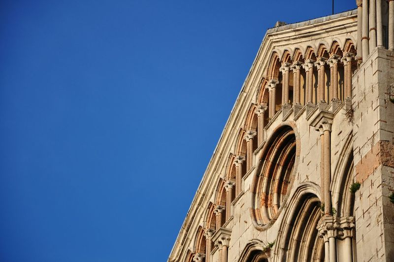 Low Angel View Of Historic Cathedral Against Clear Blue Sky