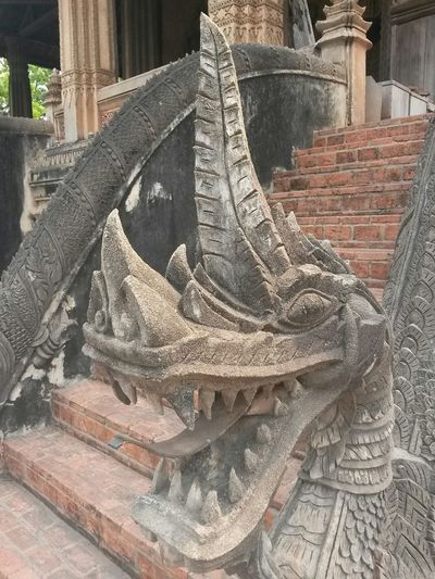 Dragon South East Asia Architecture Belief Brick Building Building Exterior Built Structure Creativity Day History Laos Metal No People Old Outdoors Place Of Worship Religion Representation Shoe Spirituality Staircase The Past