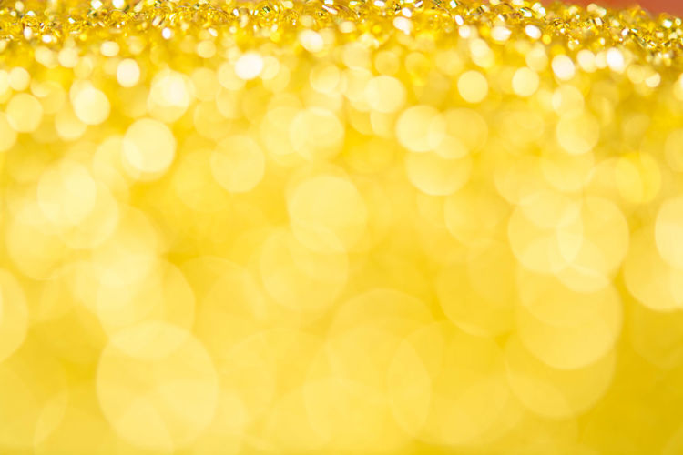 Abstract Abstract Backgrounds Backgrounds Bright Brightly Lit Celebration Circle Copy Space Decoration Defocused Glitter Gold Gold Colored Light - Natural Phenomenon Luxury No People Ornate Pattern Shiny Softness Textured  Textured Effect Vibrant Color Yellow