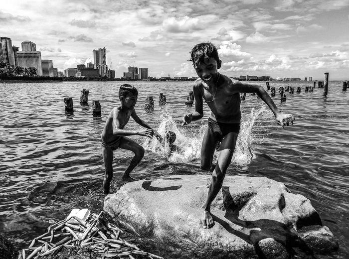 People on sea shore against sky