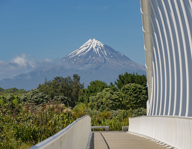 The Te Rewa Rewa bridge with Mt Taranaki (aka Mt Egmont) in the background Taranaki Beauty In Nature Cycleway Egmont Mountain New Plymouth No People Sculpture Sky Snowcapped Mountain Steel Steel Structure  Tranquil Scene Volcano Walkway White