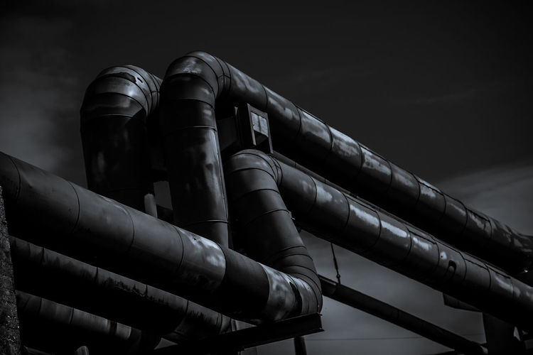 Pipe - Tube Architecture Low Angle View Built Structure Railing Outdoors Metal Man Made Object Pipe Pipeline Industrial Dark