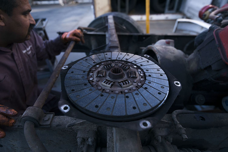 Replacing the clutch on our 1964 motorhome. Metal Real People Men Machinery Day Circle Indoors  Focus On Foreground Equipment Machine Part One Person Geometric Shape Industry Close-up Transportation Technology Incidental People Occupation Wheel Mechanic
