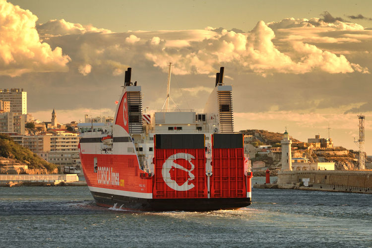 Red Ferry Clouds Sea Water City France Sky Travel Red Outdoors Marseille Europe Ferry Vessel No People FR250_MARSEILLE_AK FR250_FRANCE_AK