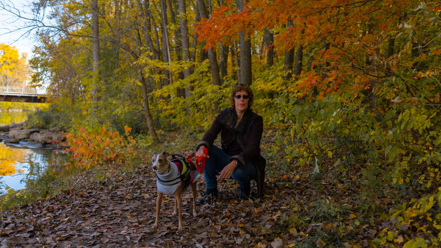 Portrait of woman with dog in autumn