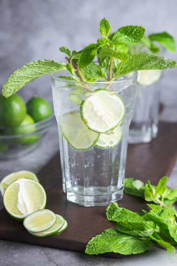 Citrus Fruit Cocktail Drink Drinking Glass Food Food And Drink Freshness Fruit Glass Healthy Eating Herb Household Equipment Leaf Lemon Lime Mint Leaf - Culinary Mojito No People Plant Part Refreshment SLICE Table
