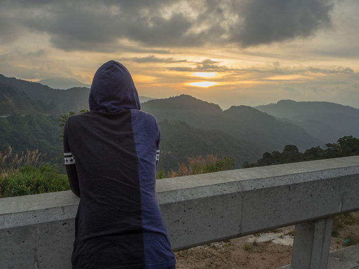 Warm Clothing Mountain Cold Temperature Standing City Sky Mountain Range Sunset Scenics