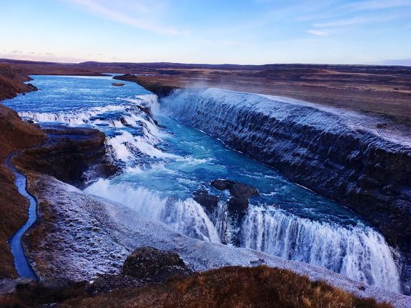 Iceland 🇮🇸 Freezing Cold Cold Day Cold Temperature Beauty In Nature Nature Scenics Water Motion Tranquil Scene Waterfall Sky Outdoors Idyllic Power In Nature Tranquility Blue Travel Destinations Landscape No People