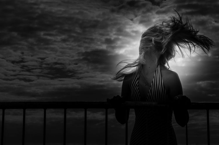 Into the wind One Person Cloud - Sky Young Adult Model Portrait Portrait Of A Woman EyeEm Atmosphere EyeEm Best Shots Monochrome Photography Sky Black And White Black And White Photography EyeEm Gallery Cloud Exceptional Photographs Black & White Monocrome Photography Fine Art Photography Darkness And Light Monochrome Melancholy Darkness Illuminated Silhouette The Portraitist - 2017 EyeEm Awards EyeEm Selects Black And White Friday