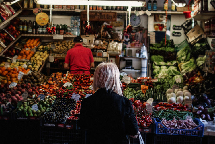 Abundance Buying Choice Customer  Discover Your City Food Food And Drink For Sale Freshness Fruit Healthy Eating Italy Large Group Of Objects Light And Shadow Market Market Stall Nikon Real People Rear View Retail  The Week Of Eyeem Travel Travel Destinations Variation Vegetable Fresh On Market 2017