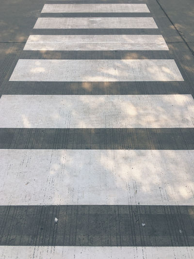 crosswalk Pattern High Angle View Day Sunlight Backgrounds Shadow No People Full Frame Flooring Nature Footpath Outdoors Direction Wood - Material The Way Forward Repetition Transportation Street Tile Architecture Crosswalk