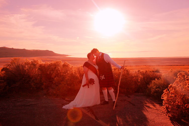 Sunset Wedding Lgbt Family Lgbt Lesbian Couple Queer Women Backlight Beauty In Nature Celtic Full Length Kilt Landscape Lesbian Lifestyles Love Nature Person Real People Scenics Sea Sky Sun Sunbeam Sunlight Sunset Sunset Silhouettes Tranquil Scene Tranquility Wedding Wedding Dress Women