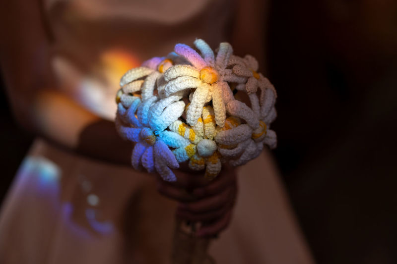 Beautiful rainbow glare on bridal bouquet One Person Midsection Human Body Part Hand Human Hand Multi Colored Close-up Focus On Foreground Holding Indoors  Adult Selective Focus Day Indulgence Temptation Wrist Human Limb Rainbow Glare Of The Sun Bridal Bouquet