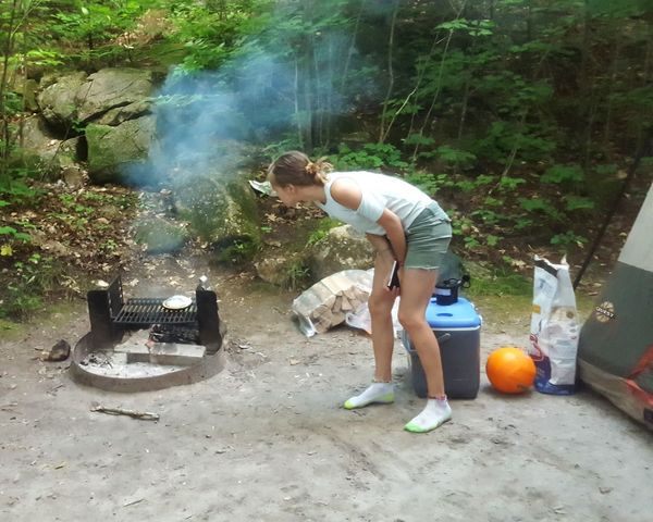 Checking on the fire Day Child Outdoors Leisure Activity Vacations Girls Nature Camping Fire Campfire