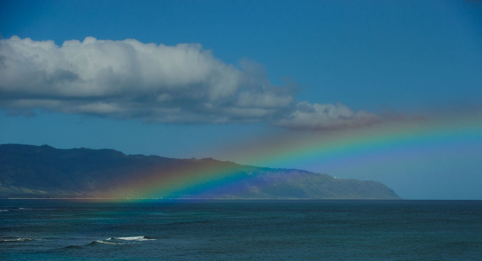 Rainbow over ocean by Ka'ena Point Hawaii Sky Scenics - Nature Beauty In Nature Rainbow Cloud - Sky Water Tranquility Tranquil Scene Nature Mountain No People Idyllic Non-urban Scene Day Waterfront Outdoors North Shore Oahu Ka'ena Point Kaena Point