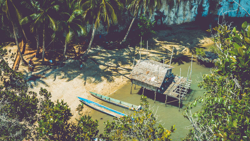 Local people tap new location, Bamboo Hut and Boats on Beach in low Tide, Kabui Bay near Waigeo. West Papuan, Raja Ampat. Indonesia Biotope Blue Lagoon Local Low Tide, Dry River Bed Raja Ampat Papua Indonesia Adventure Azureblue Biodiversity Boat Bungalows Coastlines Dwelling Endeavor Freedoom  Homestay Inhabitants Jungle Limestone Pacific Ocean Palm Trees Remote Places Smaragd Green Unspoiled Nature Untouched Villge Working Go Higher