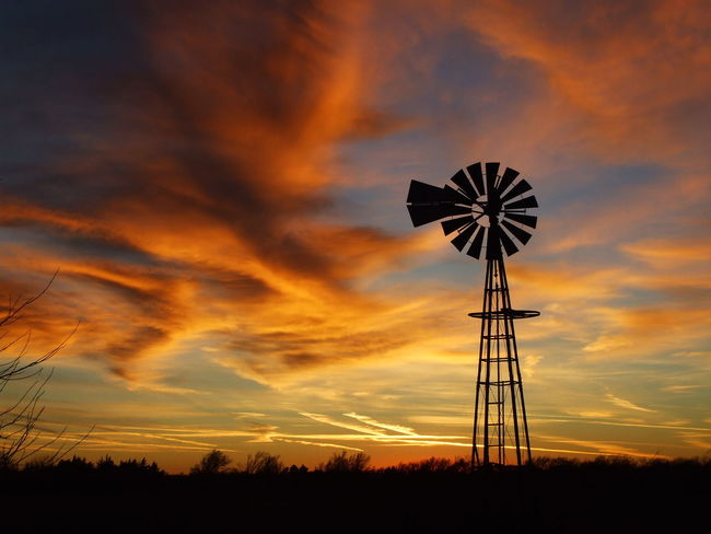 Kansas Golden Sky with a Windmill Silhouette Kansas, Cloud - Sky Evening, Horizon, Landscape, Nature Orange Color Outdoors Rural Scene Scenics Silhouette Sky Sunset Traditional Windmill Wind Power Windmill