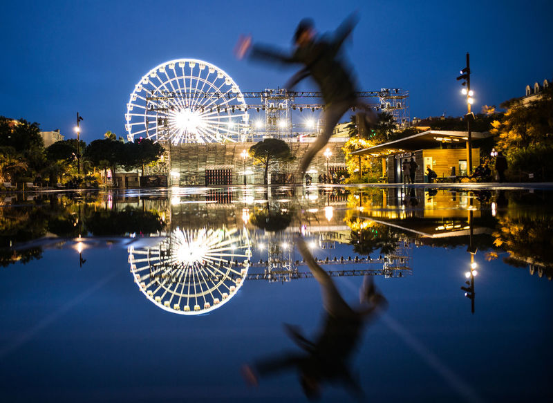EyeEm Best Shots Fun HUAWEI Photo Award: After Dark Happiness NICE By Night The Week on EyeEm Amusement Park Blurred Motion Ferris Wheel Illuminated Jumping Long Exposure Motion Night Nigtshots Reflection Sky Spinning The Jump Travel Destinations