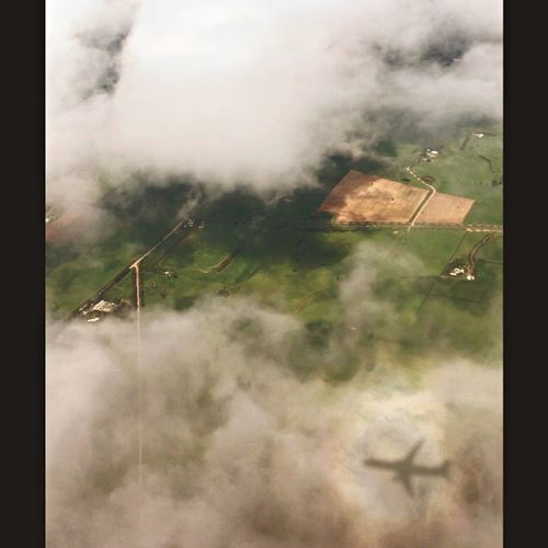 Through the clouds... another world Little Houses Below Landscape Day Field No People Outdoors Agriculture Sky Nature Beauty In Nature Tree Looking Out Of The Window Airplane Reflection In The Clouds ☁️ Looking Down Green Grass 🌱