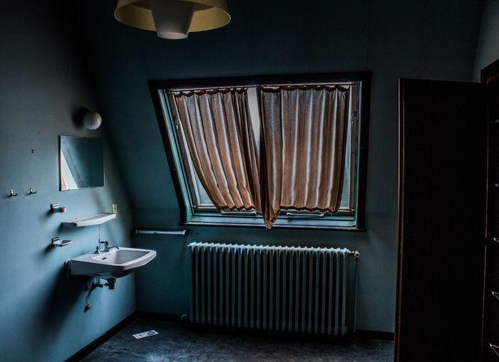 Drying radiator and wash basin in bathroom