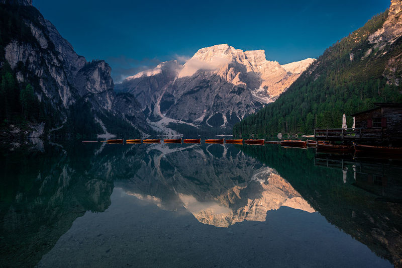 Scenic view of lake and mountains against sky in lago di braies, dolomites, italy