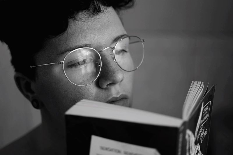 Reading material. Reading A Book Reading EyeEm Selects Headshot One Person Portrait Glasses Real People Indoors  Young Adult Eyeglasses  Young Women Looking Close-up Adult Technology Women Lifestyles Human Face