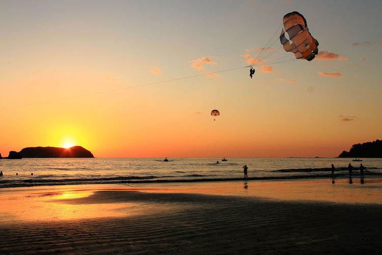 Fun on the beach The Beach  Sunset Silhouettes Paragliding Fun Sport Beach Sports. Costa Rica Vacations Holiday Holidays Travel America Exotic Exotic Destination Exotic Destinations Tourism Tourist Tourists Beach Horizon Over Water Sea Nature Outdoors Sky Land Scenics - Nature