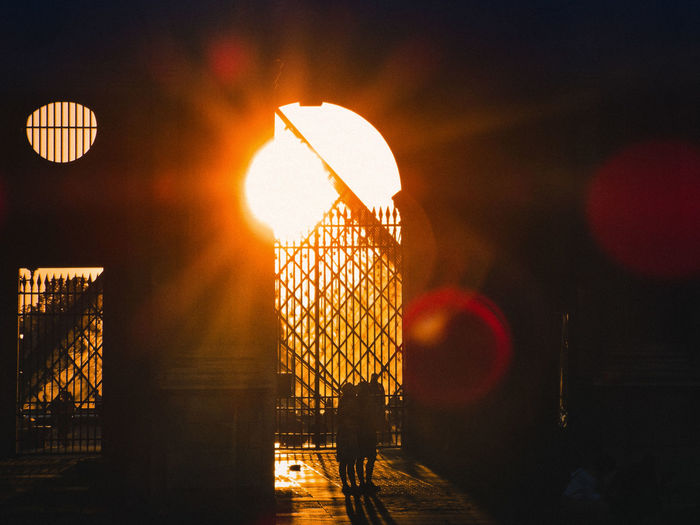 Sunset through the glass pyramid of the louvre in paris