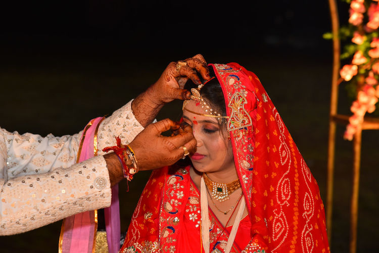 During the wedding ceremony, the groom puts sindoor on the hair  of his bride..