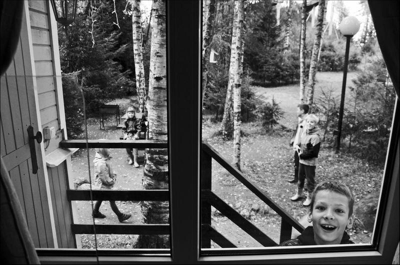 Portrait of smiling girl seen through glass window