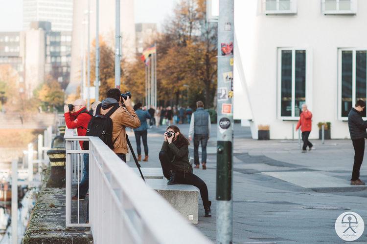 City Depth Of Field Lifestyles Men Real People Sidewalk Street Women
