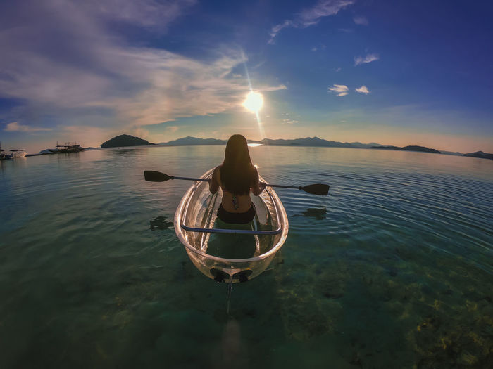Rear view of woman on boat in sea