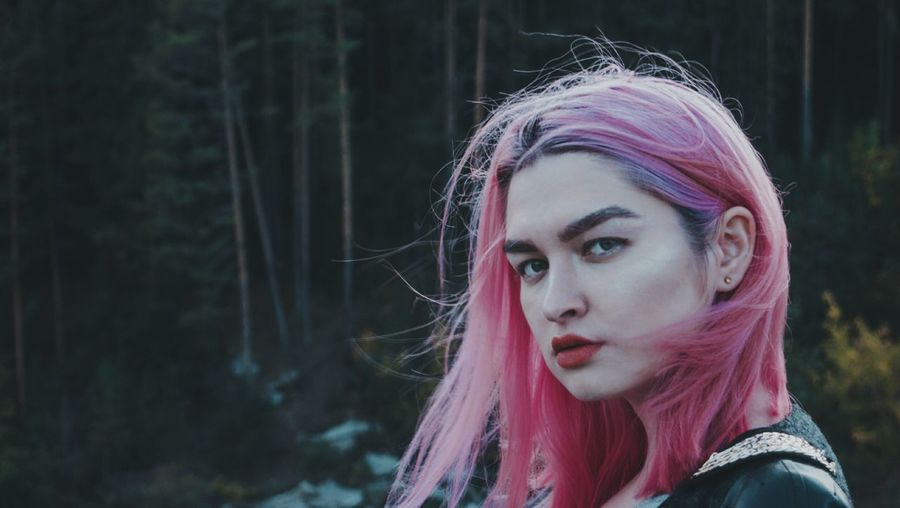 Close-Up Portrait Of Beautiful Young Woman With Dyed Hair